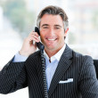 Self-assured mature businessman talking on phone — Stock Photo