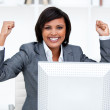 Confident businesswoman punching the air in celebration — Stock Photo #10281268