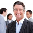 Charismatic mature businessman standing with his team — Stock Photo