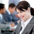 Royalty-Free Stock Photo: Smiling businesswoman in a meeting
