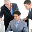 Stock Photo: Positive businessmen working at computer