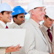 Royalty-Free Stock Photo: Condifent architect team working on a building project