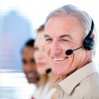 Self-assured sales representative team with headsets — Stock Photo #10281538