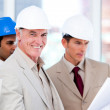 Smiling architect team working on a building project — Stock Photo