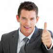 Assertive businessmwith thumb up — Stock Photo #10281694