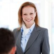 Portrait of a smiling businesswoman standing — Stock Photo