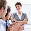 Happy business applauding a good presentation — Stock Photo #10281827