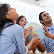 International business team holding terrestrial globe — Stock Photo #10281882