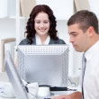 Self-assured young business working at computers — Stock Photo