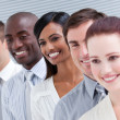Multi-ethnic young business team standing in a row — Stock Photo