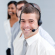 Cheerful customer service representatives standing in a line — Stock Photo
