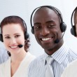 Happy customer service representatives standing in a line — Stock Photo