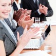 Cheerful business applauding a good presentation - Stock Photo