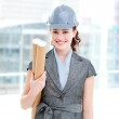Portrait of a self-assured female architect holding blueprints — Stock Photo