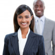 Smiling business standing in a row — Stock Photo