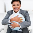 Foto Stock: Charismatic businesswomholding terrestrial globe