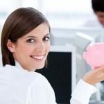 Happy businesswoman holding a piggybank — Stock Photo #10282237