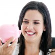 Laughing businesswoman holding a piggybank — Stock Photo #10282284