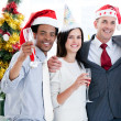 United business team drinking champagne to celebrate christmas - Stock Photo