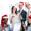 Smiling business team drinking champagne to celebrate christmas — Stock Photo