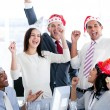 Stock Photo: Business team punching air to celebrate christmas
