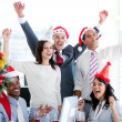 Nice business team punching the air to celebrate christmas — Stock Photo #10282317