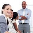 Smiling businesswoman looking at the camera during a meeting wit — Stockfoto #10282327