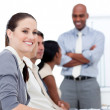 Smiling businesswoman looking at the camera during a meeting wit — Stock Photo #10282327