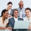 Happy mixed businessteam looking at the laptop — Stock Photo