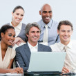 Smiling internationnal businessteam working with at the laptop — Stock Photo