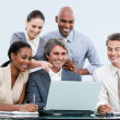 Joyful internationnal businessteam looking at the laptop — Stock Photo