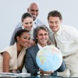 United businessteam holding a globe globalization concept — Stockfoto #10282337