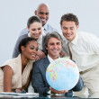 Stock Photo: United businessteam holding globe globalization concept
