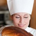 Bright female chef baking bread — Stock Photo #10282367