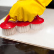 Close-up of a person cleaning a bathroom's floor — Stock Photo