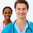 Royalty-Free Stock Photo: Portrait of two positive doctors against a white background