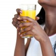Close-up of a woman drinking orange juice — Stock Photo