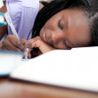 Tired teen girl doing her homework — Stock Photo
