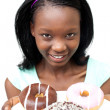 Charming young woman looking at donuts — Stock Photo #10283078