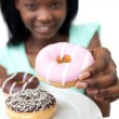 Young woman holding a donut — Stock Photo #10283082