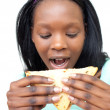 Afro-american young woman eating a sandwich — Stock Photo