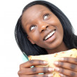 Jolly young woman eating a sandwich — Stock Photo #10283102