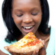 Happy woman eating a pizza — Stock Photo #10283137
