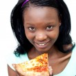 Smiling woman eating a pizza — Stock Photo #10283139