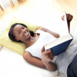 Happy teen girl studying lying on a sofa — Stock Photo #10283159
