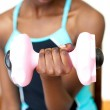 Young woman working out with dumbbell — Stock Photo