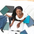 Cheerful teen girl studying sitting on her bed — Stock Photo