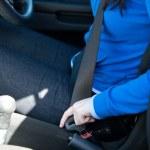 Close-up of caucasian woman putting seat belt — Stock Photo