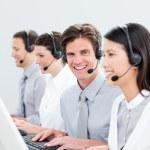 Smiling customer service representatives — Stock Photo