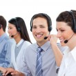 Confident business talking on headset — Stock Photo